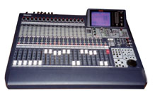 Here is a closeup picture of the mixing console. It has traditional faders, a few buttons, and a lot of lights!